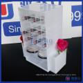 Kundenspezifischer weißer und rosafarbener Farben-drehender Acryllippenstift-Ausstellungsstandplatz