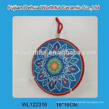 Ceramic pot mat with red lifting rope