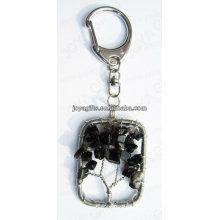 Natural La piedra negra de la viruta del ónix ató con alambr llaveros