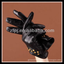 fashion designed women wearing gloves with nails leather