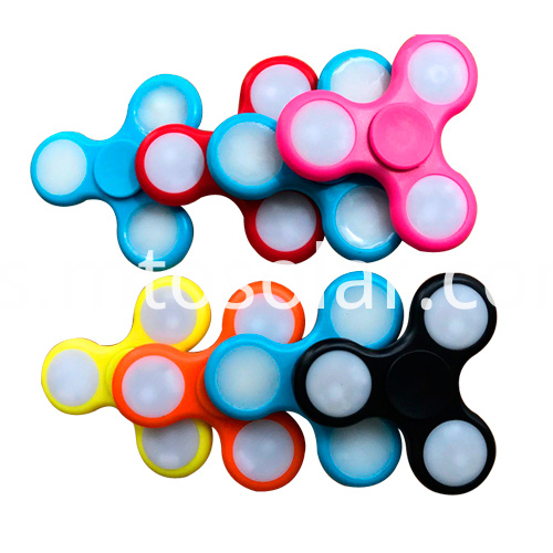 Toy fidget finger spinning top