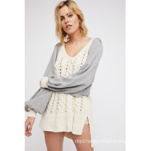 Oversized and Effortless Features Cable Sweater Fabrication with Solid Contrast Sleeves