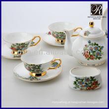 Flor colorida da venda quente com jogo do chá do jogo do café da borda dourada