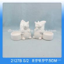 Unique squirrel shaped ceramic animal candle holders in white colour