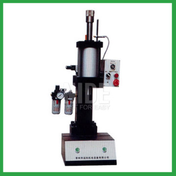 Armature shaft inserting machine