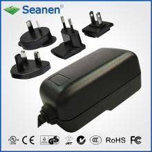 Adaptador de CA de 24 vatios con enchufes de CA intercambiables para dispositivos móviles, decodificadores, impresoras, ADSL, audio y video o electrodomésticos