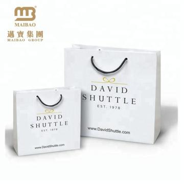 O estilo luxuoso reciclável imprimiu o saco de papel feito sob encomenda da compra do presente com seu próprio projeto do logotipo