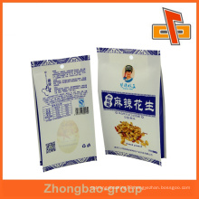 Heat sealed white kraft side gusset paper bag for Spicy peanut packaging with round hold