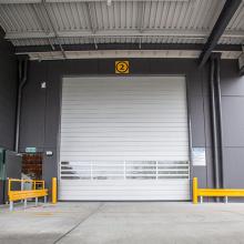 Rapid roll up plastic door with loop detector
