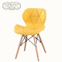 Venta al por mayor de lujo barato muebles Alibaba estilo escandinavo nórdico amarillo silla de comedor de cuero PU con patas de haya de madera