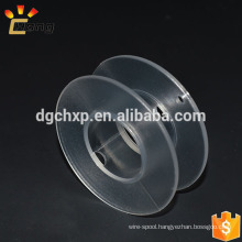 clear small plastic spool for heating wire or rope