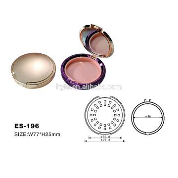 Maquillaje compacto de color dorado de forma redonda de plástico