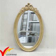 Старинное декоративное овальное деревянное настенное зеркало
