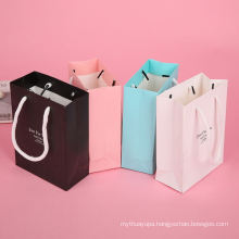 Cheap customized wholesale logo printed packaging paper gift bag with paper cord