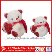 Juguetes blandos y lindos del oso de la felpa con dos alas para los regalos