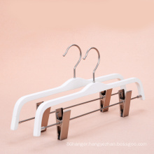 white wood laminated wood hanger with clips