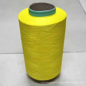 Hilo de coser de color oro 100% poliéster
