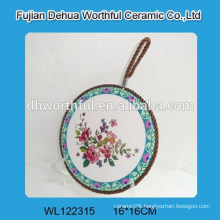Flower figure ceramic pot holder with brown rope