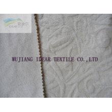 Tela flocada consolidada tejido de punto en relieve