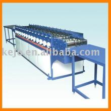 Machine à former des rouleaux de toiles ondulées