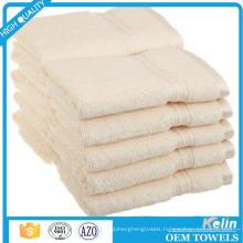 Plain white palais royale hilton hotel bath towel