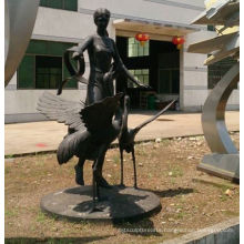 the girl and the crane made of copper or fiber glass sculpture for sale