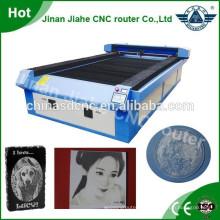 metal de 1300 * 2500mm y metal corte láser co2 láser precio de la máquina de corte