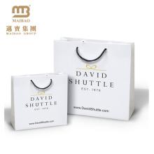De haute qualité vente en gros de luxe de luxe de boutique imprimée de cadeau de papier commercial faisant des emplettes avec le logo et les poignées