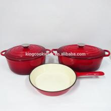 Gusseisenkasserolle des roten Emailschmelzes eingestellt - Gusseisentopf / Gusseisenpfanne