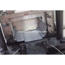 Rolo de porta do obturador que dá forma à máquina