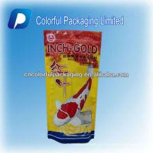 O saco de empacotamento do alimento de peixes / parte superior colorida do zíper dos alimentos para animais levanta-se acima do saco de empacotamento