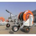 Sistema automático de controle de irrigação com carretel de mangueira de água