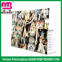La fábrica directa de Guangzhou personalizó las pequeñas bolsas de papel para ir de compras