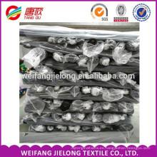 Uso de prendas de vestir Ropa de trabajo de algodón y tejido TC Twill tc 133x72 2/1 tejido de tela de camisas teñido de sarga a la India