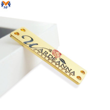 Etiquette logo en métal plaqué or