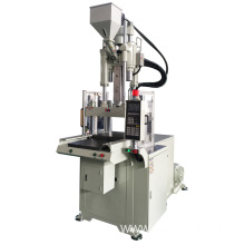 Vertical injection machine for electronics