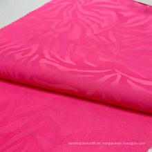 Hellrosa Zebrapunktmuster Polyester fluoreszierende Farbe 75D gewebter Jacquard-Satin-Stoff für Kleidung