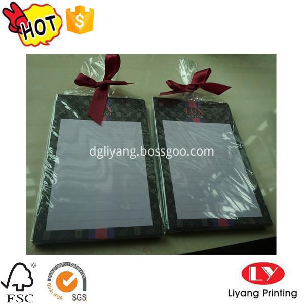 notepad with ribbon bag