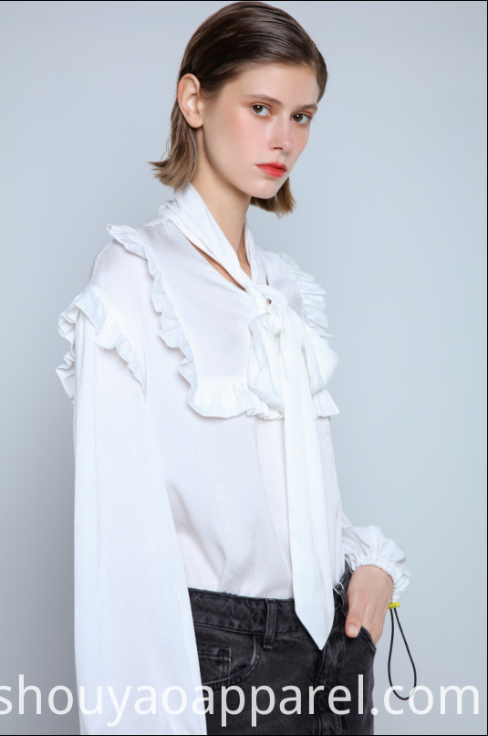 Flowing blouse with high neck and bow