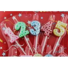 Velas de cumpleaños coloridos números con titular