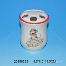 Lovely ceramic tooth brush holder with monkey decal