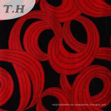 Tela flocado negro y rojo