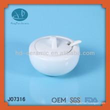 white ceramic storage jar with spoon