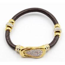 Черный кожаный браслет Gunine с золотым украшением из нержавеющей стали и застежкой