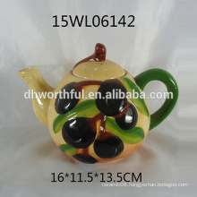 Hand painted ceramic teapot with olive design