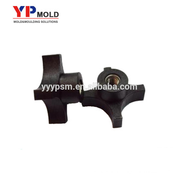 Black plastic covering handle nut insert Mold