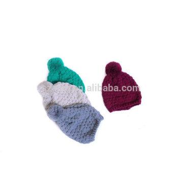 Sombrero de acrílico del pom pom del knit del color sólido del invierno de las mujeres