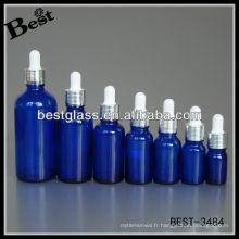 Bouteille d'huile essentielle bleue avec vis argentée shinning bouchon en aluminium, caoutchouc blanc, compte-gouttes en verre; flacon compte-gouttes avec bouchon en aluminium