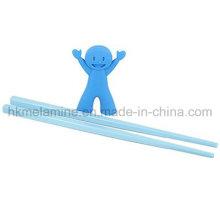 Children Training Chopsticks with Helper