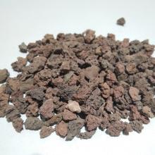 Meios de filtro naturais da rocha vulcânica para a purificação da água de esgoto da cidade